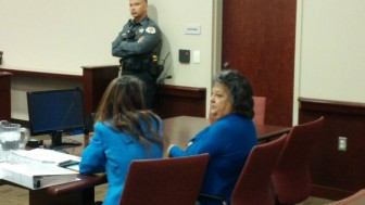Attorney Erlinda Johnson (l) and her client Dianna Duran (r) awaiting a judge's decision on her plea deal.