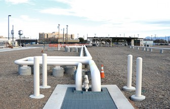 To help prevent spills, all the pipes at the bulk fuels facility are either above ground or in a concrete-lined trench, where they can be seen through a heavy steel grate. (Photo by Lee Ross, from Kirtland Air Force Base website)