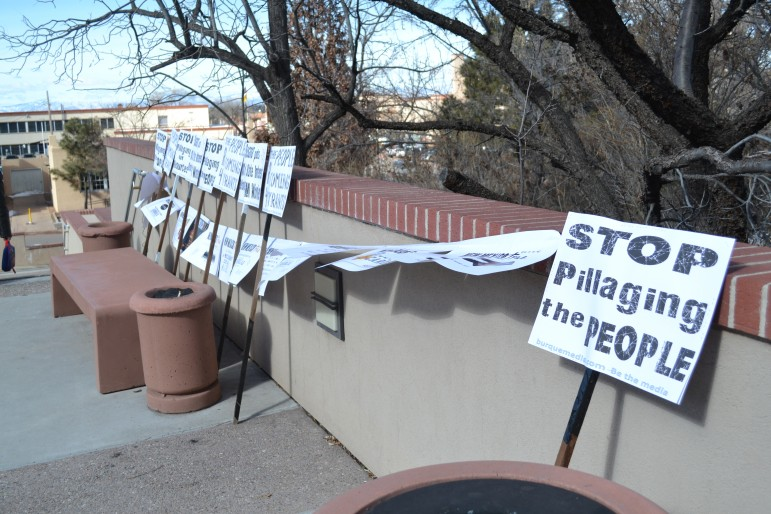 Signs made for a protest ahead of the start of the legislative session. Photo Credit: Andy Lyman.