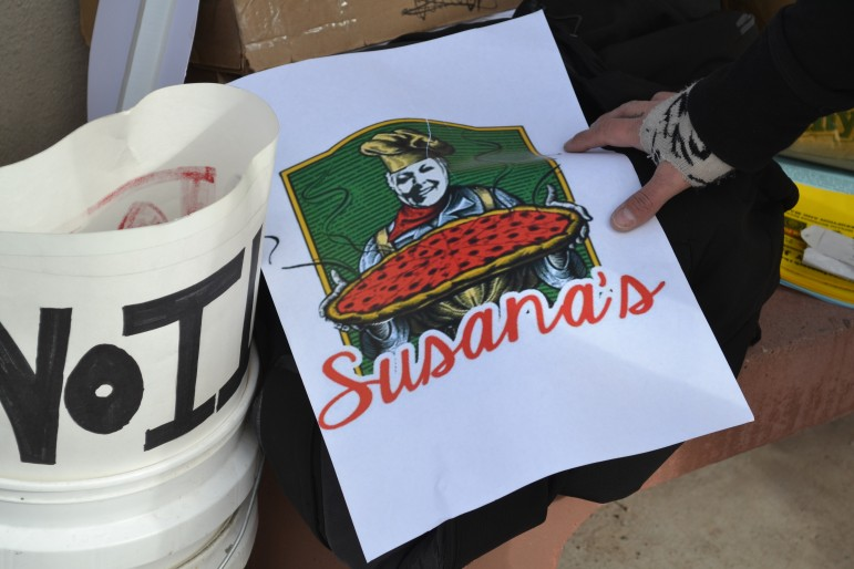 Labels made for pizza boxes by Occupy New Mexico