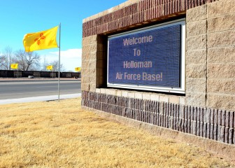 The New Mexico flag waves in the breeze on Jan. 6, 2009, at the front gate of Holloman Air Force Base. The flags replaced the normal presentation of U.S. Flags, New Mexico state flags and German flags in honor of New Mexico's admittance into the union on Jan. 6, 1912. (U.S. Air Force photo/Airman 1st Class Deandre Curtiss)