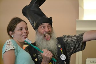 2016 Presidential Candidate Vermin Supreme poses with a fan