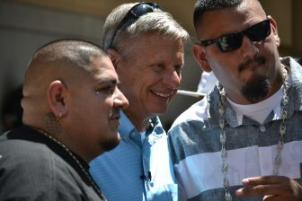 Gary Johnson poses for a picture during a lowrider event