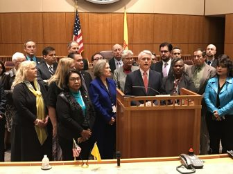 State Sen. Clemente Sanchez, D-Grants, surrounded by fellow House and Senate Democrats at a Thursday news conference talks about the economic package Democrats are advocating.
