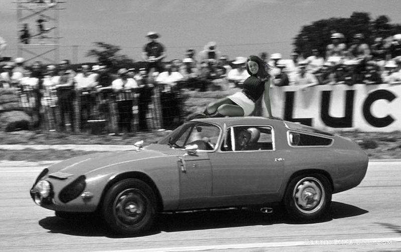 Sebring race queen holding on for dear life at Sebring in 1967.  Walker Fricks, Jr. photo.