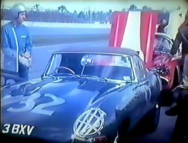 David Hobbs next to his E-type Jaguar prior to the start of the race.