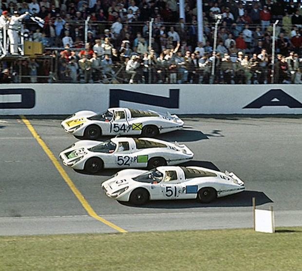 <strong>The Porsche 1-2-3 finish at the 1968 24 Hours of Daytona. Coming in first is the #54 Porsche 907 of Vic Elford and Jochen Neerpasch. Second is the #52 Porsche 907 of Jo Siffert and Hans Hermann. In third place is the #51 Porsche 907 of Jo Schlesser and Joe Buzzetta.</strong>