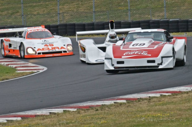 Chevrolet Corvette, followed by Miles Jackson in Lola Frisbee and Parker Johnstone's Spice Acura GTP-Light