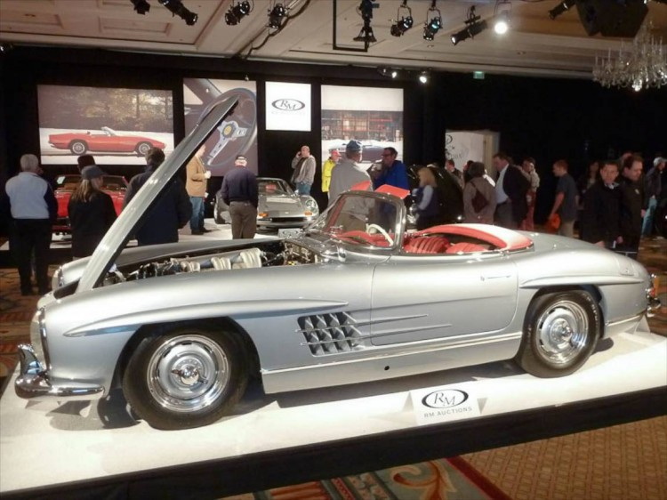 Lot # 122 1957 Mercedes-Benz 300SL Roadster; S/N 1980427500569; Engine # 1989807500545; Silver-Blue/Red leather; Dark Blue cloth top; Estimate $1,400,000 - $1,750,000; Older restoration, 2+ condition; Hammered Sold at $1,675,000 plus commission of 10.00%; Final Price $1,842,500 – Euro headlights, Rudge wheels, Dunlop blackwall tires, Becker radio, books, tools, Rudge spare wheel and tire. – First owned by 19-year old actress Natalie Wood, who had it painted pink from the original Silver. Restored in the present intriguing shade in 2000. Class winner at Amelia Island in 2012. In impeccable condition showing slight evidence of use but meticulously maintained with excellent paint, chrome, interior and gauges. – The celebrity provenance is a slight bonus in the value of this gorgeous 300SL, which brought a realistic price amongst the exaggerated valuations placed on similar cars these days.