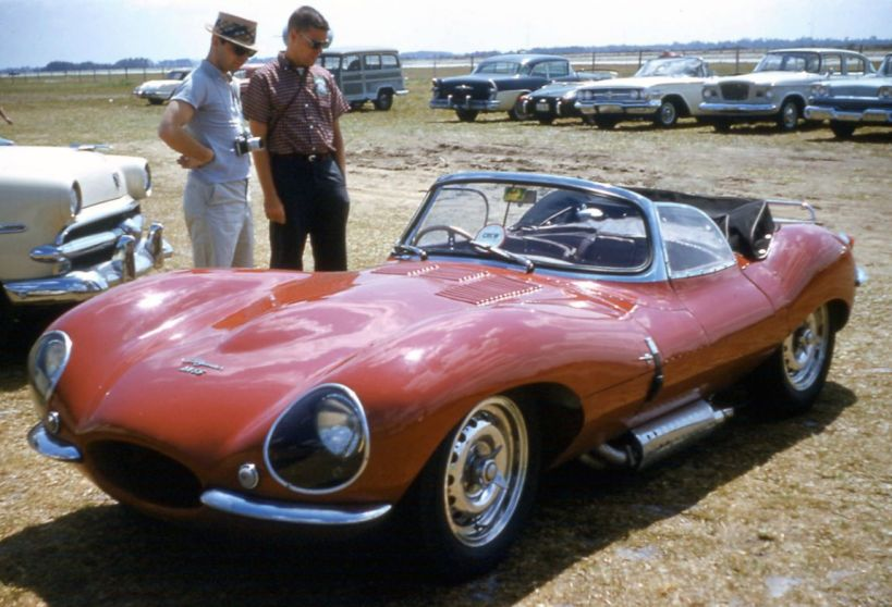 Half the fun of going to Sebring has always been viewing exotic cars in the paddock. On the left Dave Nicholas admires a Jaguar XKSS. BARC boys photo.