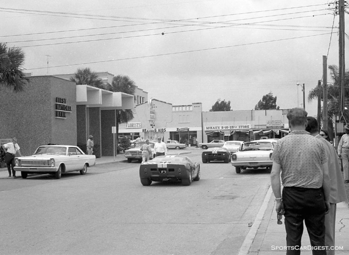 Downtown Sebring and locals witness two Shelby Ford GT40's on their way back to the track after completing tech inspection. In order to get inspected you had to drive, or tow, your unlicensed race car several miles from the track to the downtown fire station. (photo: Dave Nicholas)