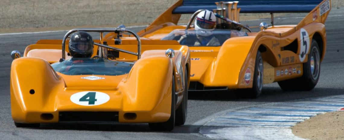 Richard Griot's 1967 McLaren M6A leads Chris MacAllister's 1971 McLaren M8F-1 in turn two.