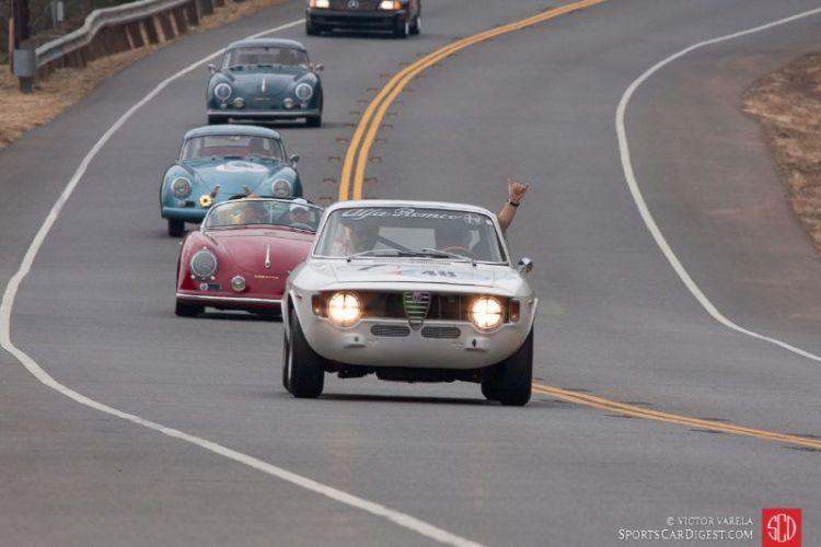 Gareth Ashworth leads the start of the rally in his 1965 Alfa Romeo GTA