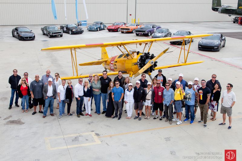 Rally group photo in front of a Boeing Stearman Model 75 biplane