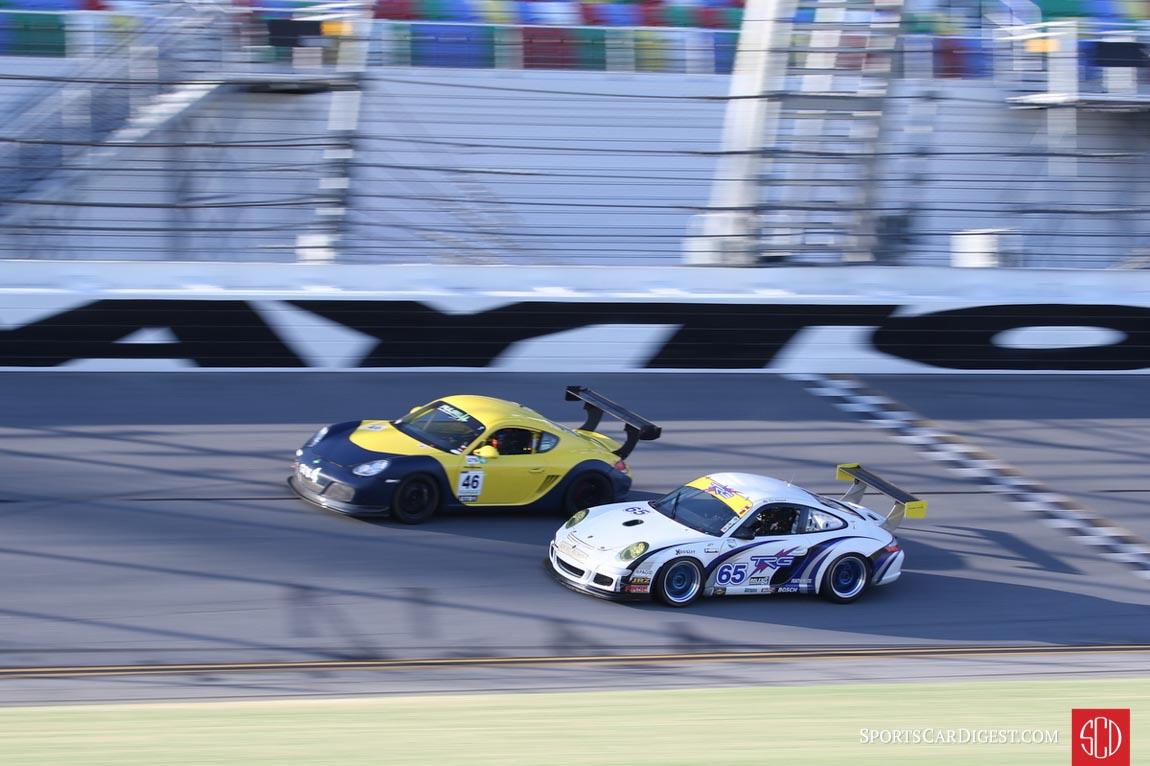 Aristotle Balogh, Porsche Cayman, and Don Ondrejcak, Porsche 997 Cup dueling on the front straight.