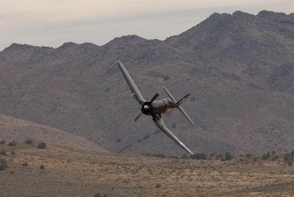 Head high Doug Matthews sets the Corsair F4U-4 sights on pylon #6