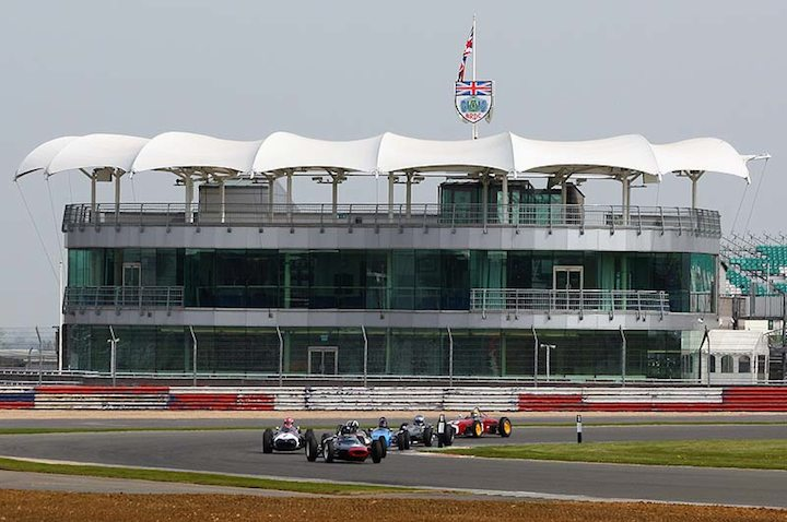 The HGPCA Pre-66 Grand Prix car field in front of the BRDC centre