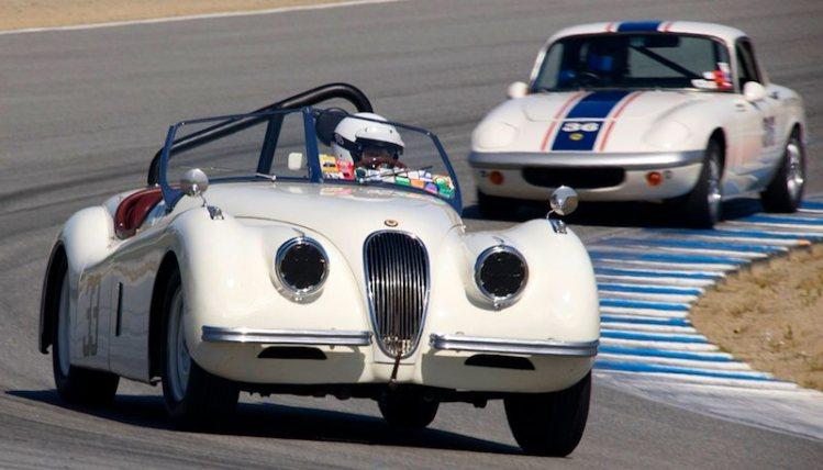 James Alder's 1952 Jaguar XK120 leads the 1966 Lotus Elan of Michel Avila out of turn five.