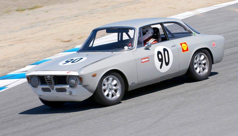 David Buchanan's 1966 Alfa Romeo GTV starts the drop into the Corkscrew.