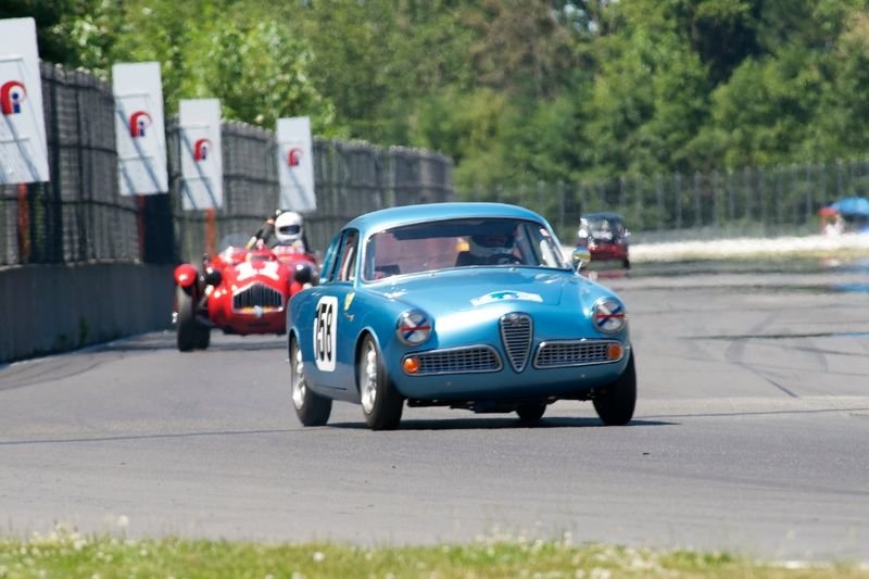 Down the back straight, Daniel Higgins' 1958 Alfa Romeo Giulietta Sprint.