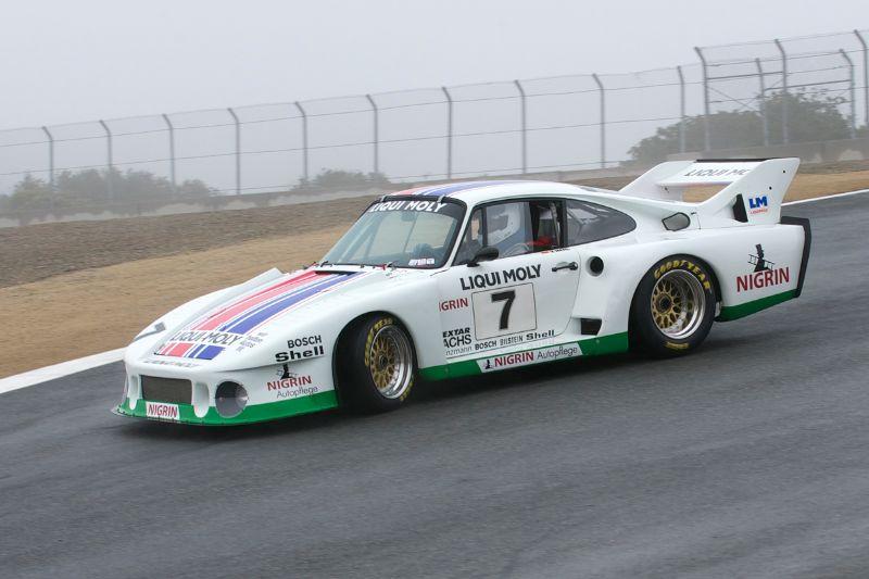 1979 Porsche 935J driven by Stephen Harris on a wet slippery tra