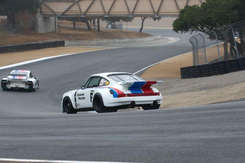 Alan Benjamin's Porsche RSR 3.0 chases Stephen Harris' Porsche 935 J down the Corkscrew.