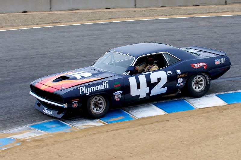 Over the crest Andy Boone in his 1970 Plymouth Barracuda.