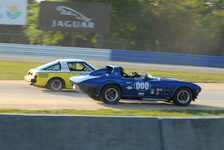 Ken Mennella- 1963 Corvette overtakes Mazda RZ-7 of Chauncy Wallace.
