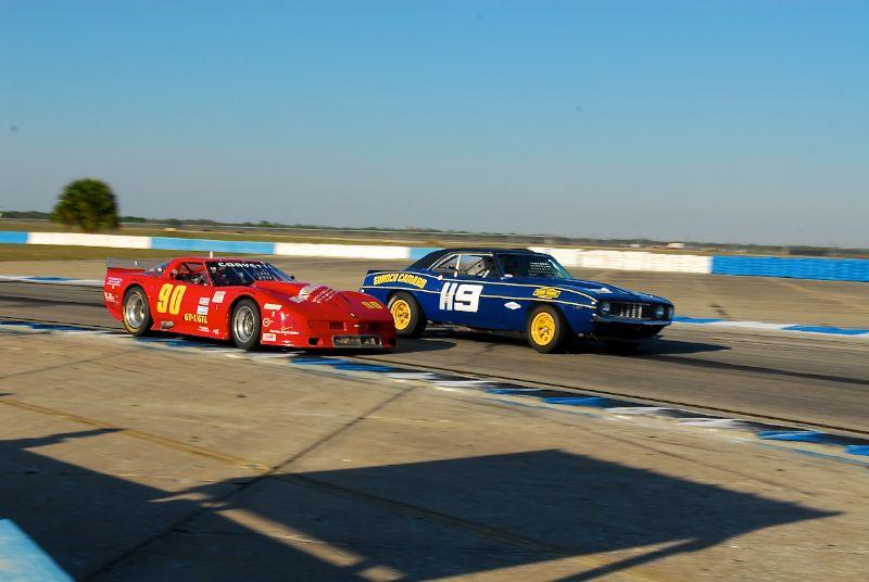 Jeff Bernatovich, GT1 Corvette, overtakes the Camaro of Leonard McCue.