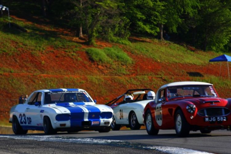 Jim Gregg, 57 Austin Healey 100-6, Warren Leveque, 66 Corvair Yenko Stinger and George Balbach, 61 Porsche 356 coming out of turn 5