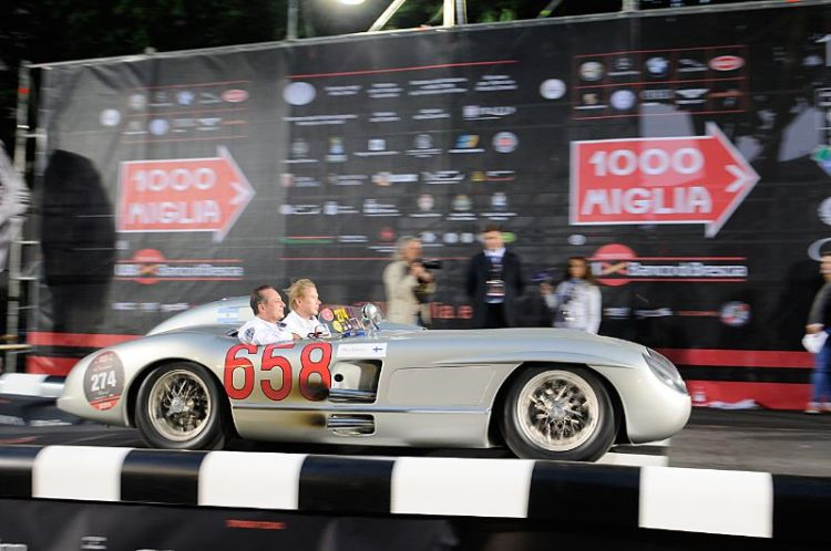 Mika Hakkinen and Juan Manuel Fangio II in Mercedes-Benz 300 SLR. In 1955, Juan Manuel Fangio finished second in the Mille Miglia in an identical car.