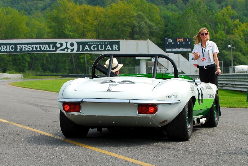 Renea Topp helps place the Group 44, Jaguar Series III, V12 E-Type.