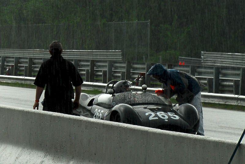 Sandy McNeil in the rainy pits, 1958 Cooper Monaco T49.