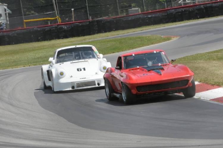Merle Henry- '67 Corvette and #61- Stanley Crawford 1974 Porsche 911RSR.
