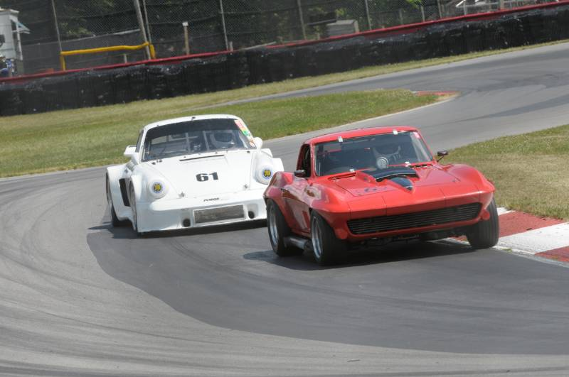 Merle Henry- '67 Corvette and #61- Stanley Crawford 1974 Porsche 911RSR.