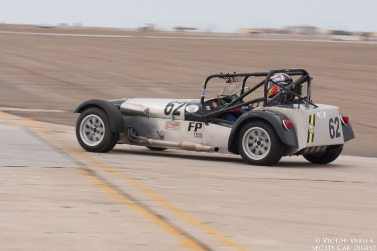 James Smith enters turn 11 in his 1962 Lotus Seven. © 2014 Victor Varela