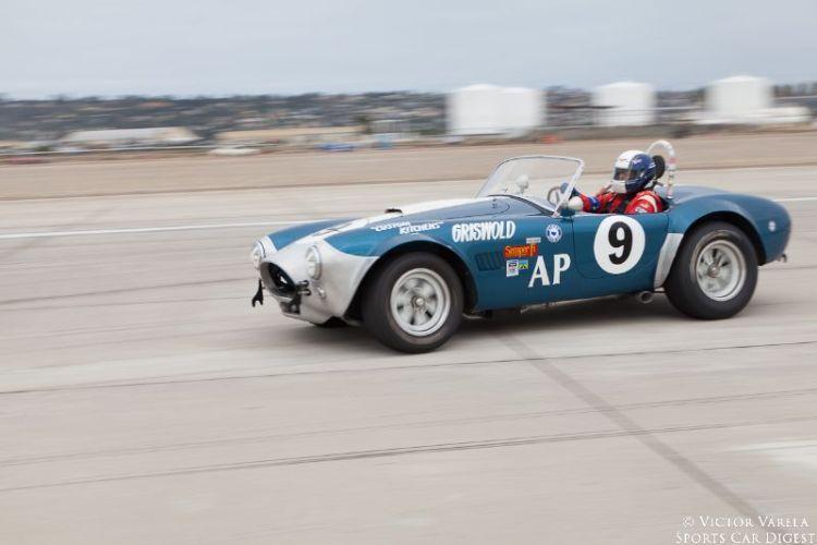 John Goodman prepares for turn 10 in his 1964 Cobra. © 2014 Victor Varela