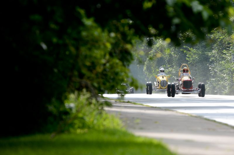 A pair of Sprint cars make their way down the Boulevard of Allies.