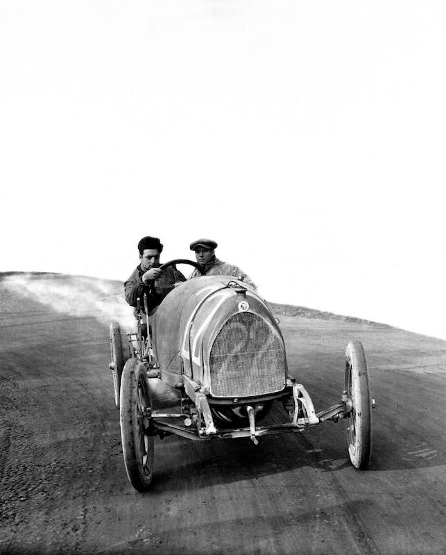 Enzo Ferrari testing with the mechanic Nino Berretta. In the race, even if he came out of maximum time, he was classified in 9th place. The car was a 15-20 HP CMN. CMN stands for National Mechanical Constructions based in Milan.