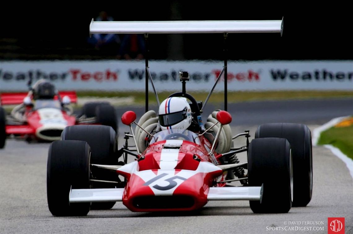 Mark Harmer is framed by the lovely exhausts on his 69 Surtees TS-5.