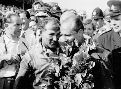 British Grand Prix, 1955: Winner Stirling Moss and runner-up Juan Manuel Fangio on the winners' podium.