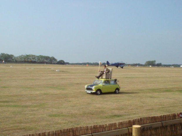 As 50 years of the Mini was celebrated, Rowan Atkinson  as Mr. Bean flew round the circuit and across the field in this Mini with an armchair on it!