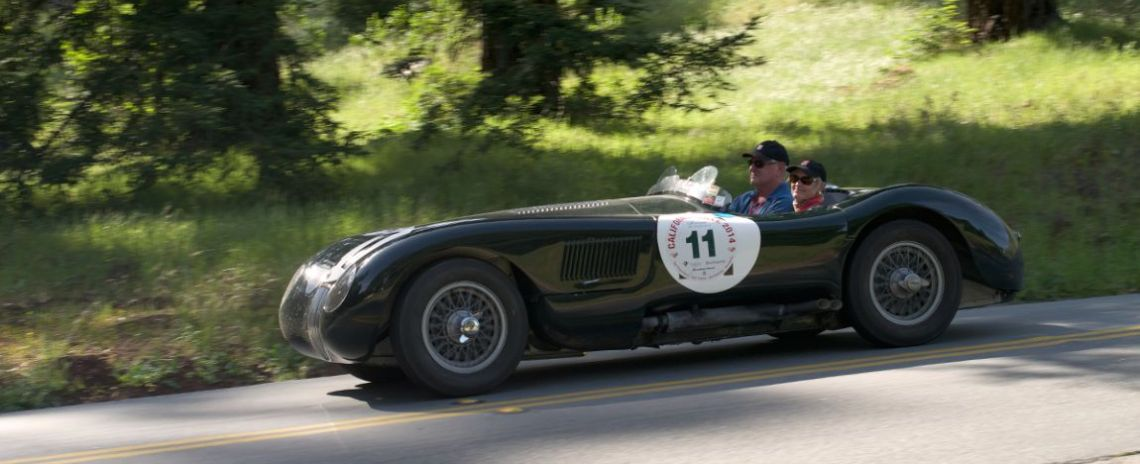 Tom and Gwen Price in their 1953 Jaguar C-Type.