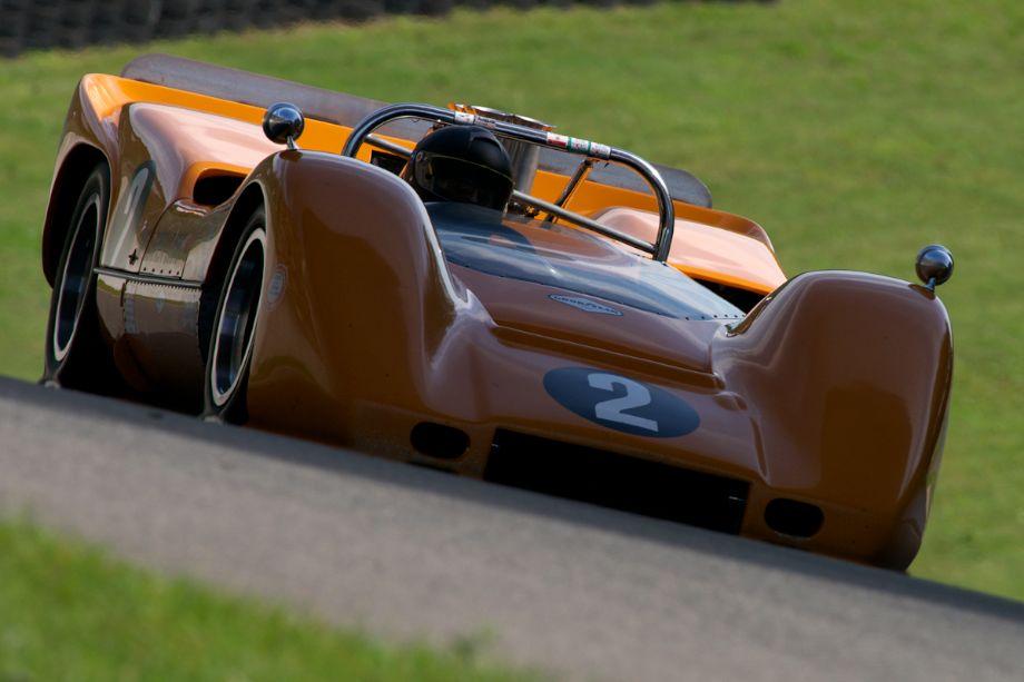 Robert Ryan's 1968 McLaren M6B goes under the bridge.