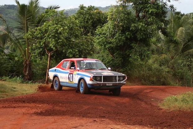 Geoff Bell's slides his Datsun 180B through turn