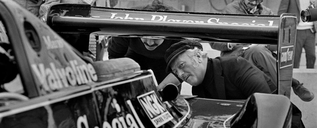 Colin Chapman inspects the back of Mario Andretti's Lotus 79