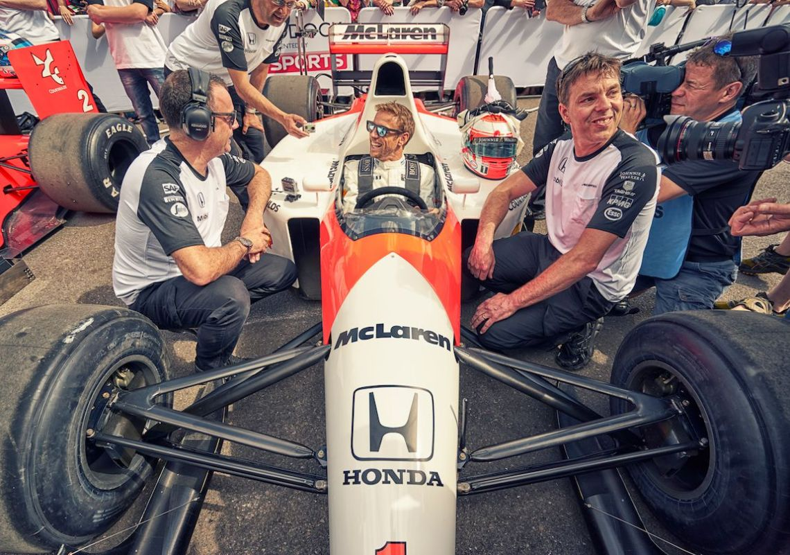 Jenson Button enjoys a moment in the McLaren MP4/6