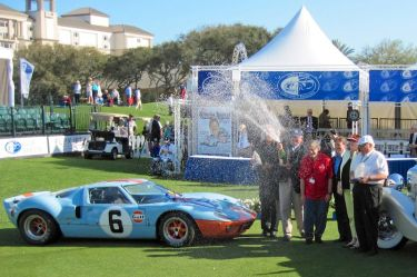 Concours Chairman Bill Warner cracks open the champagne (photo: Al Wolford)