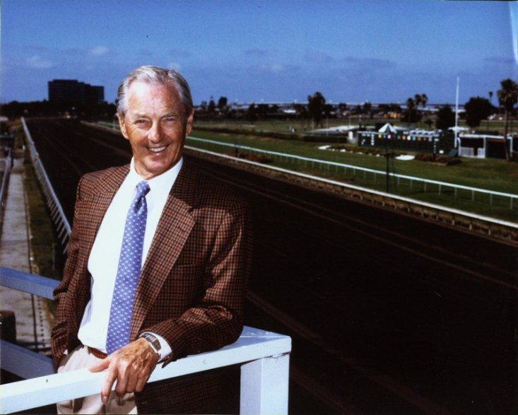Besides the business of automobiles, Qvale's other passion was breeding and racing race horses. This hobby lasted for more than four decades and at its peak, Qvale owned more than 100 horses. This photo of Mr. Q at the horse race track was used for the cover of his autobiography, published in 2005.