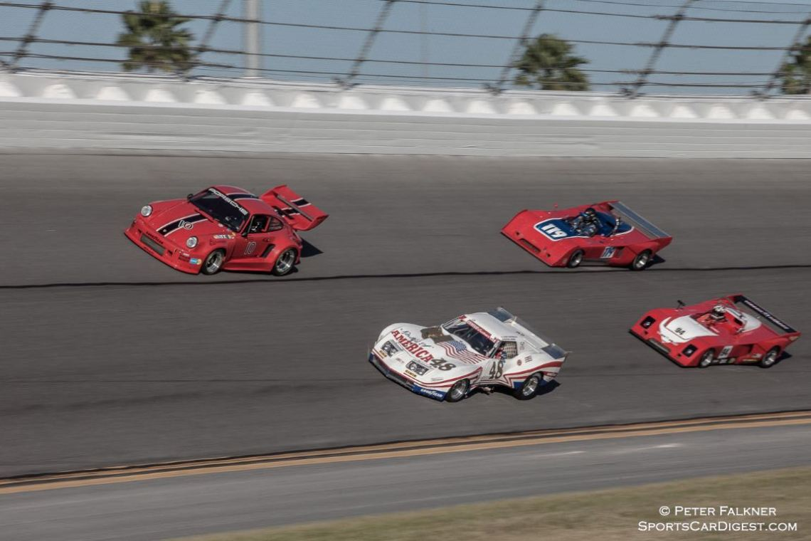 Porsche, Corvette and 2 Chevrons on their pace lap. #119 1976 Chevron B 36 was the Classic 24 group B winner